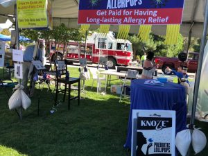 "Knoze Jr present AllerPops to the local community at ScienceFest of Los Alamos, NM. Na Leng, and Brian Han help prepare the booth for the quiz on ""how to raise an allergy-free child."